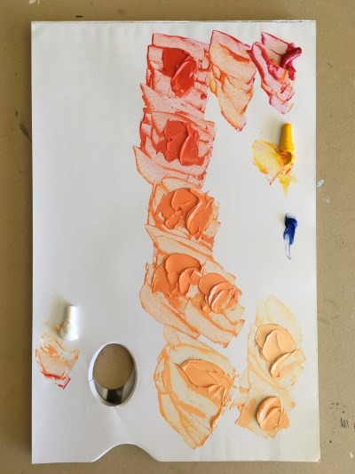 Mixing colors on a paper palette